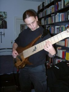 Very Young Alexander Claas with his second instrument ever built. 8-string bass from 2006